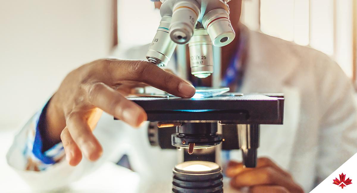 person using a microscope