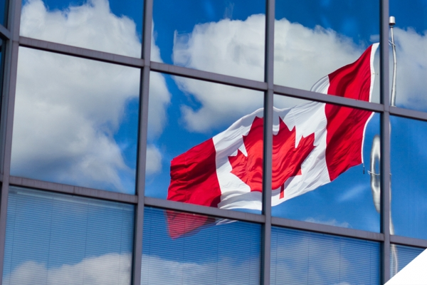 Canada flag reflected in office building