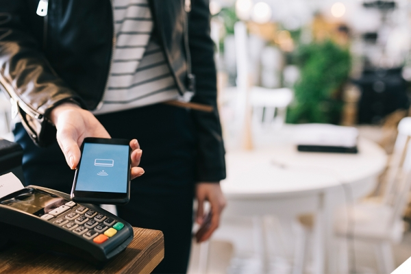 person using cellphone to pay
