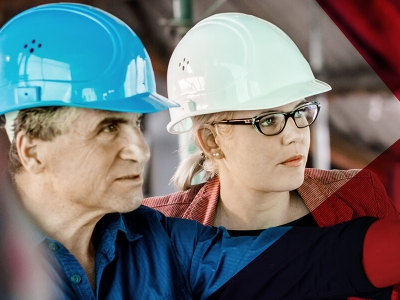 Man and woman wearing hard hats