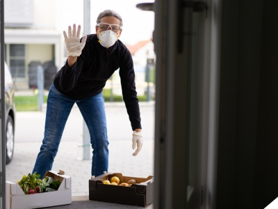 women wearing mask and delivering groceries